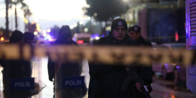 Turkish police officers secure the site of an explosion outside the courthouse in Izmir on January 5,...