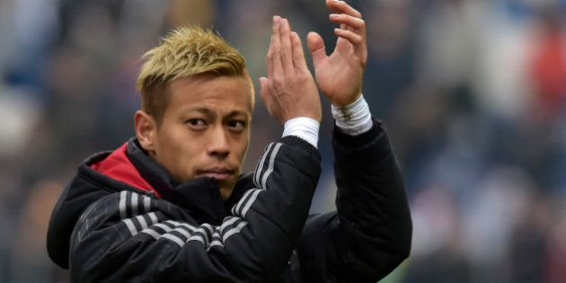 AC Milan's Keisuke Honda greets fans at the end of a serie A soccer match between Sassuolo and AC Milan...