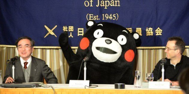 Kumamon gestures during a press conference at the foreign correspondents' club in Tokyo on February 14,...