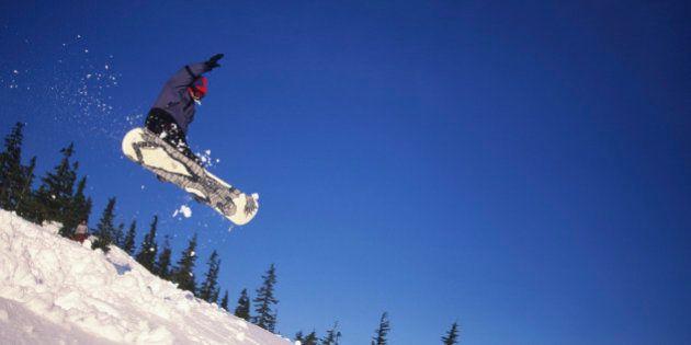 Mt Washington ski resort - boy jumping on snowbord, Vancouver Island, British Columbia,