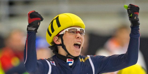 Jinkyu Noh of Korea celebrates after winning the men's 5000 m relay final race of the ISU World Cup short...