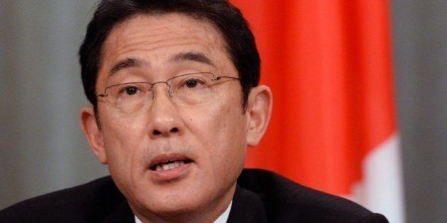 Japanese Foreign Minister Fumio Kishida speaks during a joint press conference with his Russian counterpart...