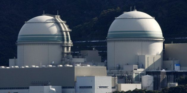 The No. 3, left, and No. 4 reactor buildings stand at Kansai Electric Power Co.'s Takahama nuclear power...