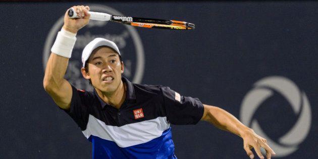 MONTREAL, ON - AUGUST 13: Kei Nishikori of Japan hits a return against David Goffin of Belgium during...