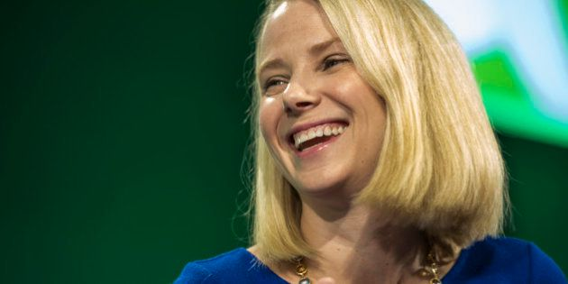 Marissa Mayer, president and chief executive officer at Yahoo! Inc., laughs during the 2015 Bloomberg...