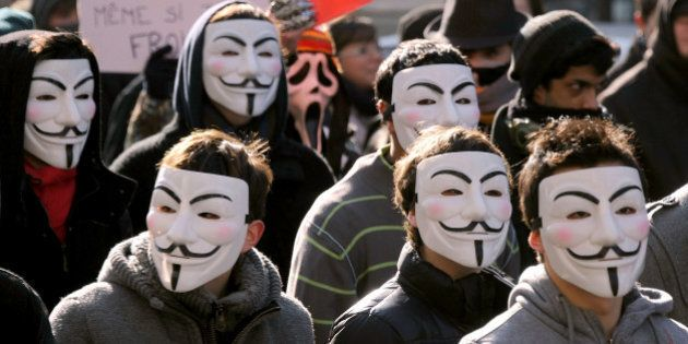 Demonstrators wearing Anonymous Guy Fawkes masks attend a protest against the Anti-Counterfeiting Trade...