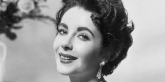 circa 1952: Promotional portrait of British-born actor Elizabeth Taylor smiling, wearing a sleeveless...