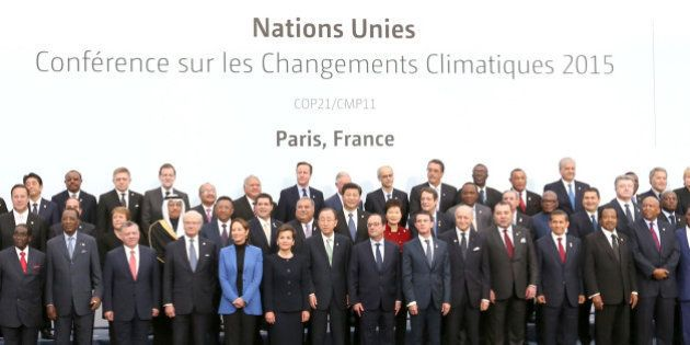 PARIS, Nov. 30, 2015-- Chinese President Xi Jinping, eighth left in second row, poses for a group photo...