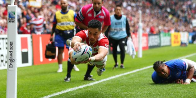 MILTON KEYNES, ENGLAND - OCTOBER 03: Akihito Yamada of Japan scores his teams second try during the 2015...