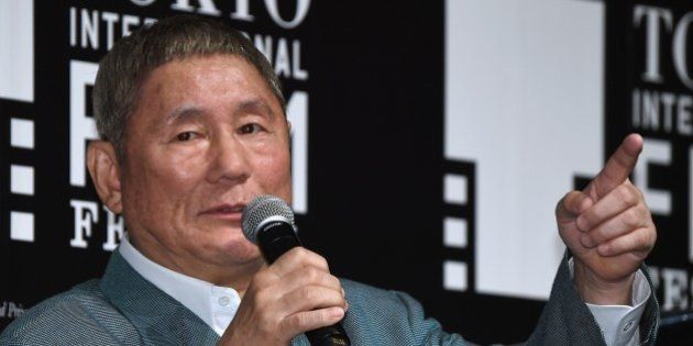 Japanese movie director Takeshi Kitano gestures as he answers questions after winning the first Samurai...