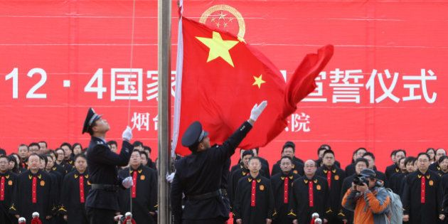 YANTAI, CHINA - DECEMBER 04: (CHINA OUT) Judges make a pledge during China's first National Constitution...