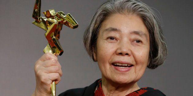 Japan actress Kiki Kirin poses after winning the Lifetime Achievement award of the Asian Film Awards...