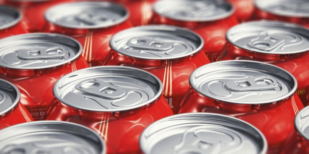 Macro view of color drink tin cans with cola soda beverage with selective focus