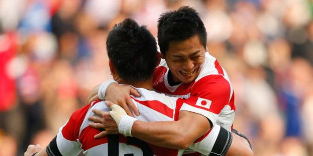 MILTON KEYNES, ENGLAND - OCTOBER 03: Kosei Ono (R) and Ayumu Goromaru of Japan celebrate victory after...