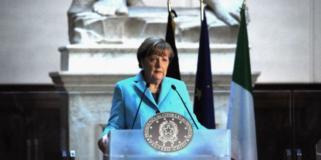 FLORENCE, ITALY - JANUARY 23: German Chancellor Angela Merkel speaks during a press conference inside...