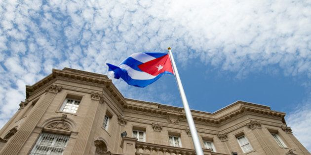 The Cuban flag is raised over their new embassy in Washington, Monday, July 20, 2015. Cuba's blue, red...