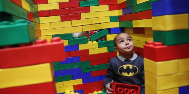 LONDON, ENGLAND - NOVEMBER 27: Marli Williams, 9, plays in a Lego building area on the opening day of...