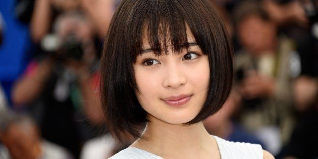 Japanese actress Suzu Hirose poses during a photocall for the film 'Umimachi Diary' (Our Little Sister)...