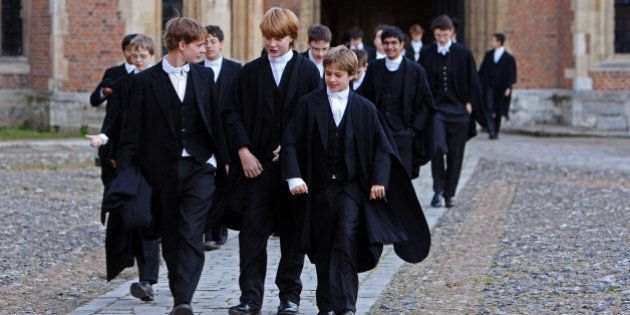 ETON, ENGLAND - MAY 26: Boys make their way to classes across the historic cobbled School Yard of Eton...