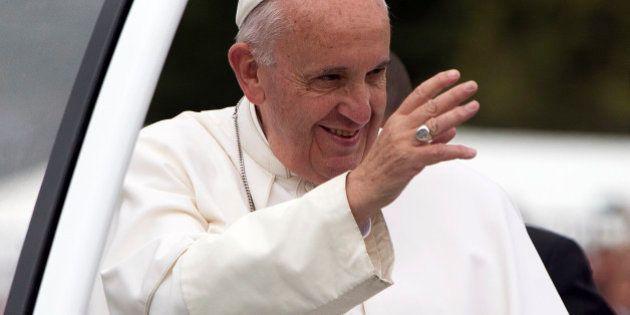 Pope Francis parades in the popemobile along the Benjamin Franklin Parkway in Philadelphia, Sunday, Sept....