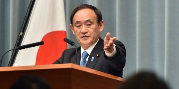 Japanese Chief Cabinet Secretary Yoshihide Suga speaks to reporters after a cabinet meeting at prime...