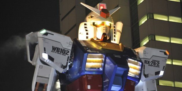 An 18-metre tall statue of popular TV animation hero Gundam is lit up at a park in Shizuoka city, 150km...