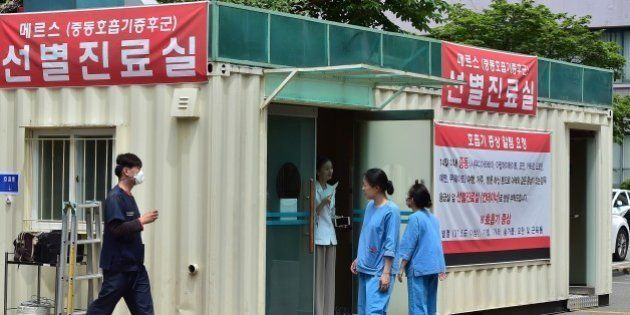 South Korean hospital workers set a separated emergency center for MERS cases at the National Medical...