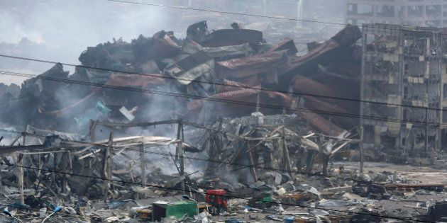 Deformed containers pile up at the site of an explosion at a warehouse in northeastern China's Tianjin...