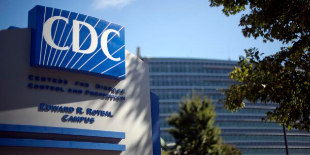 FILE - In this Oct. 8, 2013, file photo, a sign marks the entrance to the federal Centers for Disease...