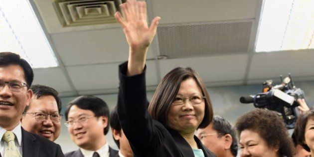 Tsai Ing-wen (C), chairwoman of Taiwan's main opposition Democratic Progressive Party (DPP), waves during...
