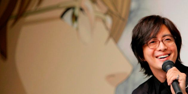 South Korean actor Bae Yong-joon smiles during a news conference to promote the animation version of...