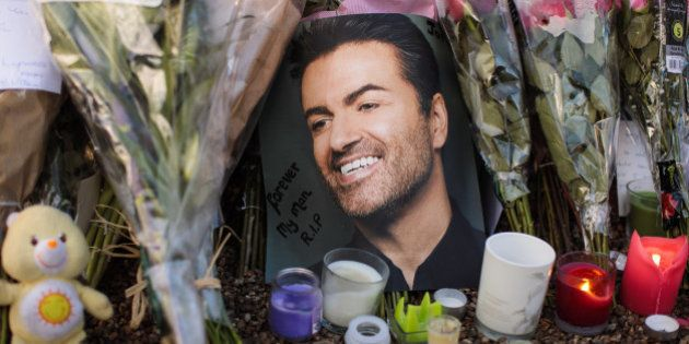 LONDON, ENGLAND - DECEMBER 28: Tributes of flowers, photographs and candles are left outside the home of pop music icon George Michael in The Grove, Highgate on December 28, 2016 in London, England. Singer George Michael died on Christmas day in his country home in Oxfordshire at the age of 53 on December 25.  (Photo by Jack Taylor/Getty Images)
