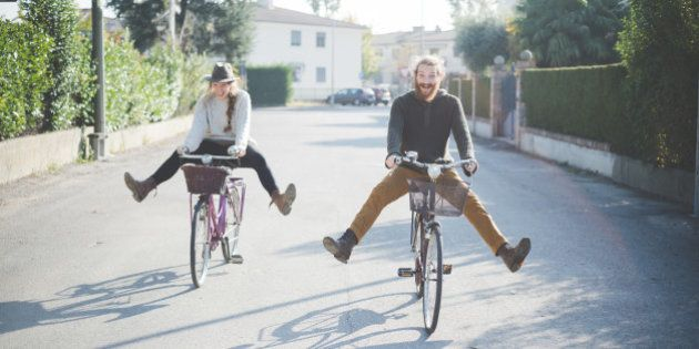 Young couple cycling with legs