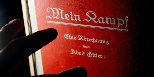 A signed copy of a first edition of Adolf Hitler's book Mein Kampf goes on display at Bloomsbury auction...