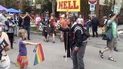 7歳の女の子 レインボーフラッグを持って同性婚反対運動に立ち向かう