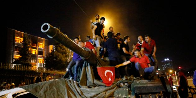 People stand on a Turkish army tank in Ankara, Turkey July 16, 2016. REUTERS/Tumay
