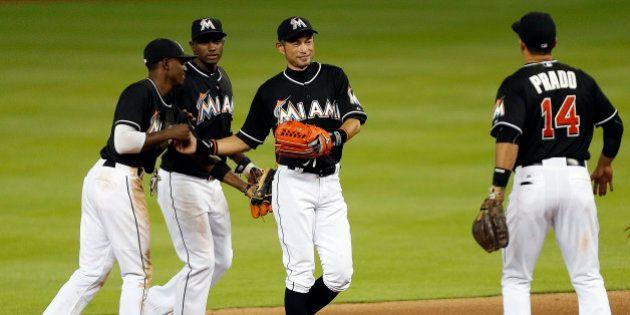 MIAMI, FL - APRIL 25: Ichiro Suzuki #51 of the Miami Marlins celebrates with teammates after breaking...