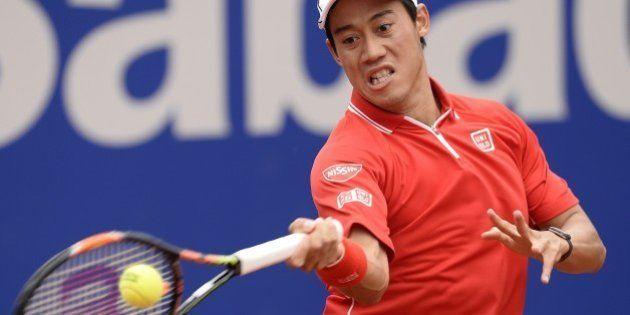 Kei Nishikori of Japan plays a return to Martin Klizan of Slovakia, during the Barcelona open tennis...
