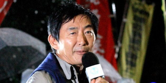 TOKYO, JAPAN - SEPTEMBER 17: Actor Junichi Ishida speaks during a protest against the new Japan Security...