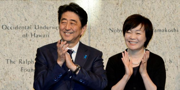 Japan's Prime Minister Shinzo Abe, left, and his wife Akie Abe attend a reception at the Japanese American...