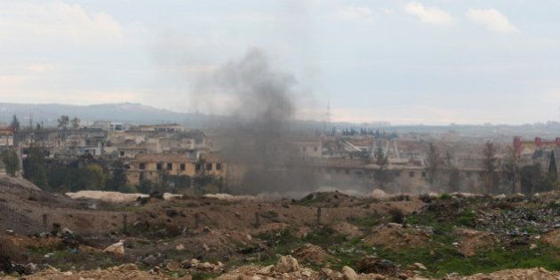 ALEPPO, SYRIA - JANUARY 05: Smoke rises as Islamic Front members clash with the Assad regime forces in...