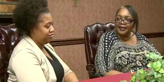 In this frame grab from video provided by WKBN-TV, La-Sonya Mitchell-Clark, left, sits next to her birth...
