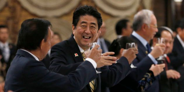 Japanese Prime Minister Shinzo Abe, second from left, raises a toast with Brunei's Sultan Hassanal Bolkiah,...