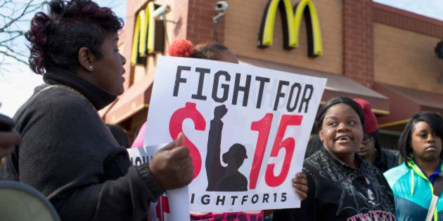CHICAGO, IL - APRIL 15: Demonstrators gather in front of a McDonald's restaurant to call for an increase...