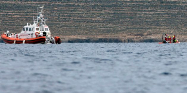 Italian Coast Guard personnel recover a body bag on their patrol boat in Lampedusa island, Italy, Tuesday,...