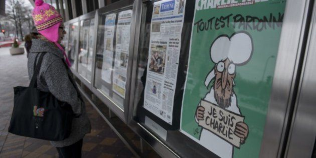 The cover of the French satirical newspaper Charlie Hebdo featuring the Prophet Mohammed is seen displayed...
