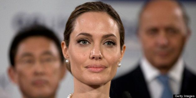 US actress Angelina Jolie in front of G8 foreign ministers speaks at a G8 Foreign Ministers press conference...