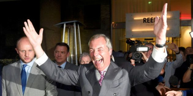 Nigel Farage, the leader of the United Kingdom Independence Party (UKIP), reacts at a Leave.eu party...