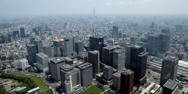 Commercial buildings, bottom, stand in the Marunouchi and Otemachi districts in this aerial photograph...