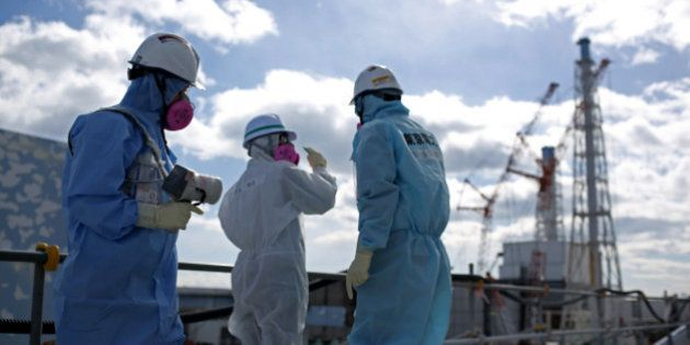 OKUMA, JAPAN - FEBRUARY 25: A TEPCO employee uses a radiation monitor as they show a member of the media...